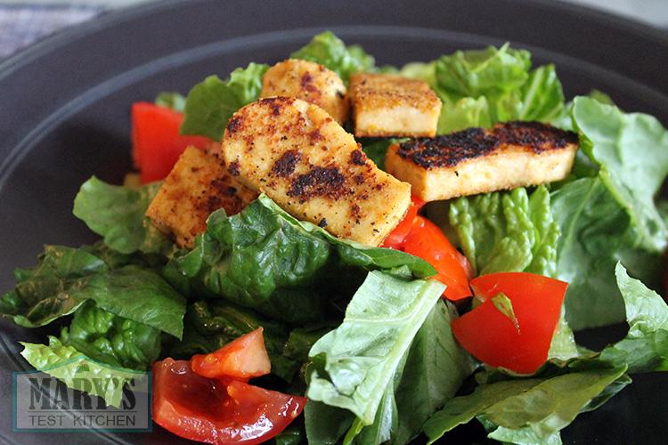 Charred five spice tofu on salad